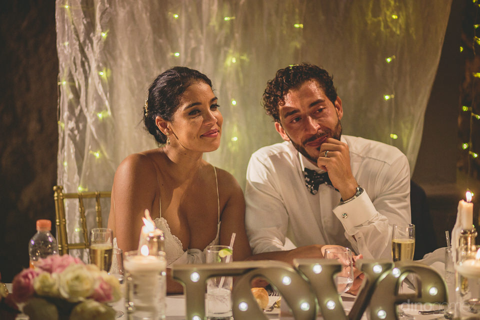 glamorous newlyweds sit at dinner table at destination wedding a