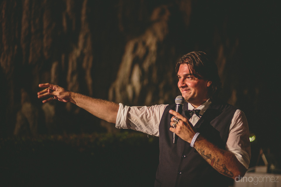 best man speaks at luxury cabo destination wedding reception at
