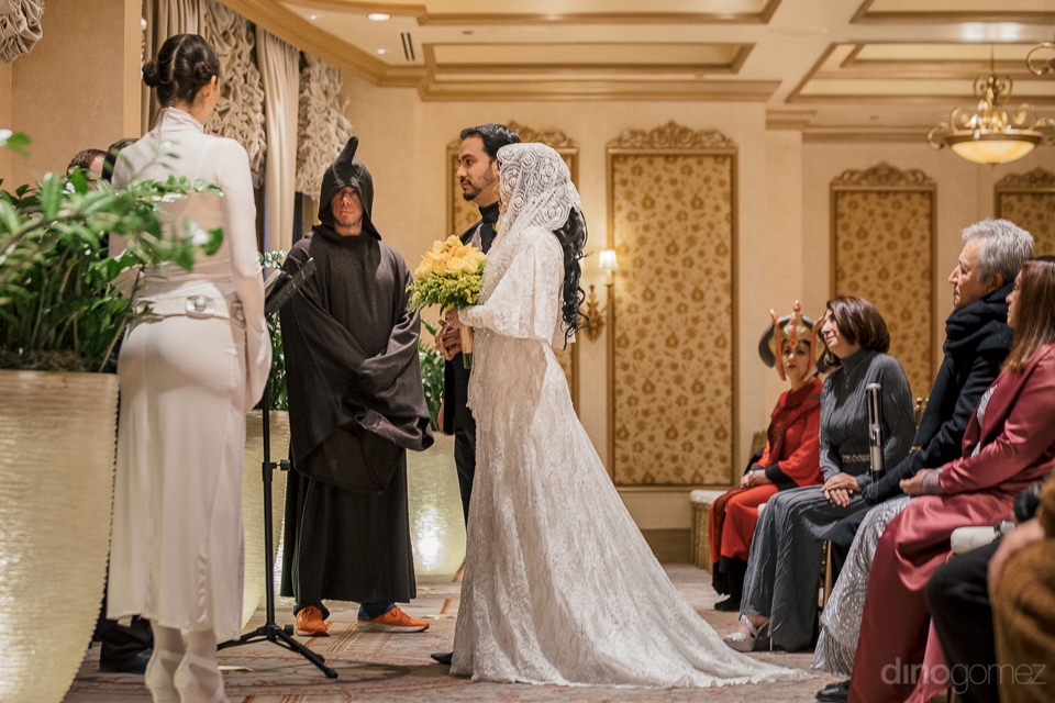 wedding hall full of star wars dressed wedding guests with bride