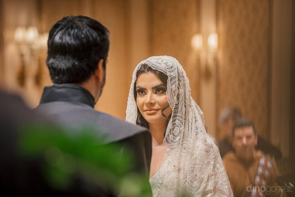 bride gazes lovingly at groom during their star wars wedding cer