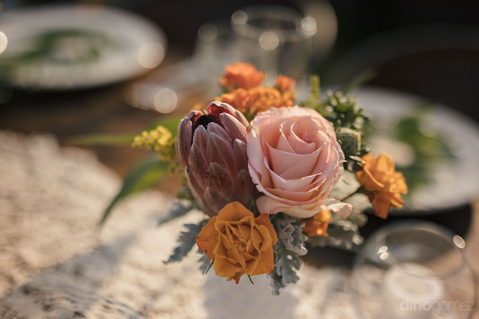 centerpieces and wedding florals on dinner table at destination