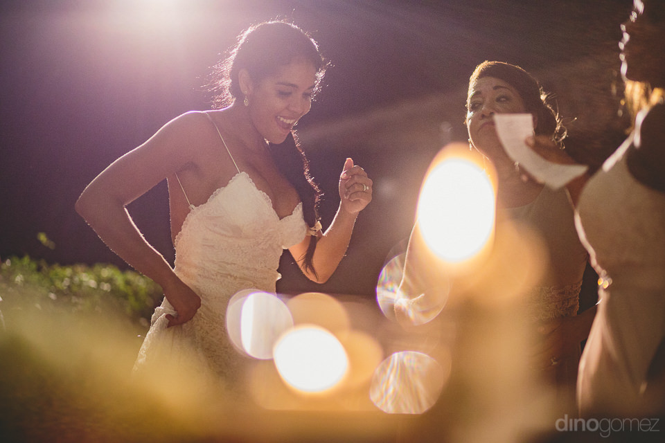 enthusiastic bride dances with friends during wedding reception