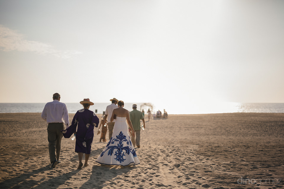 wedding guests walking on rancho pescadero beach to wedding alta