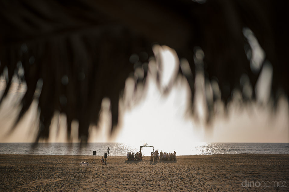 view from palapa of small intimate wedding ceremony on the beach