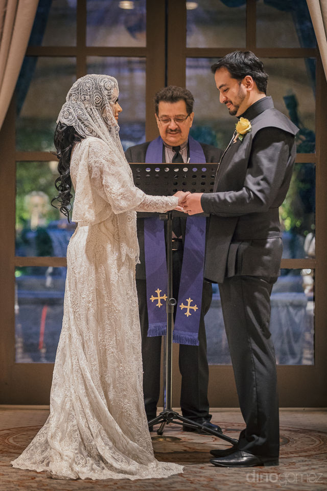 bride and groom standing at altar dressed as jedi and princess a