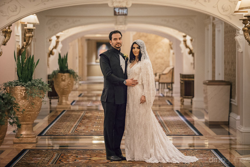 newlyweds in opulent hallway of venetian casino in las vegas aft