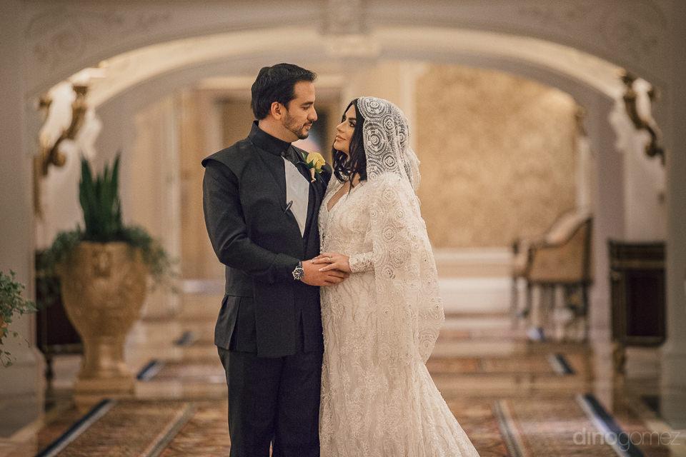 newlywed couple embrace inside las vegas best destination hotel