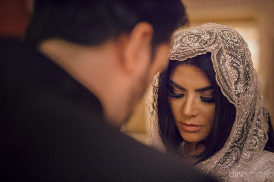 closeup photo of brides face wearing intricate delicate bridal v