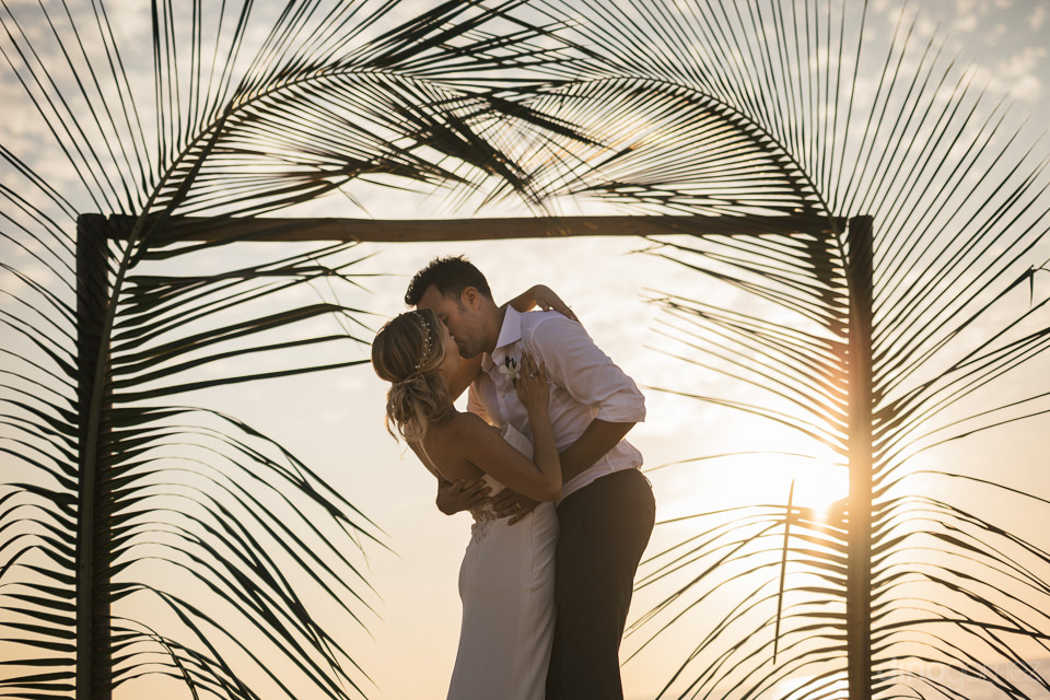 bride and groom kiss at wedding altar after being pronounced hus
