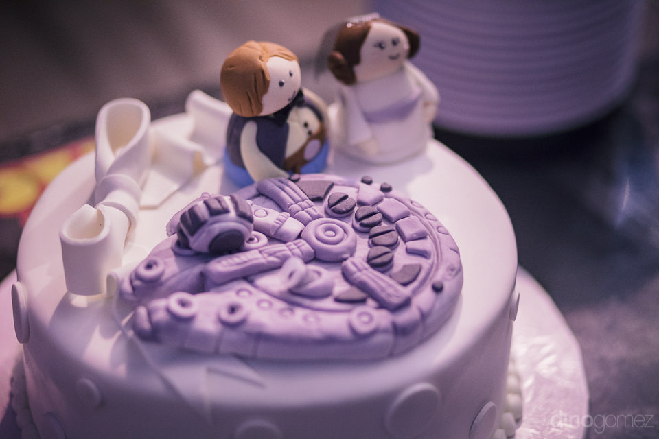 star wars wedding cake with millennium falcon and bride and groo