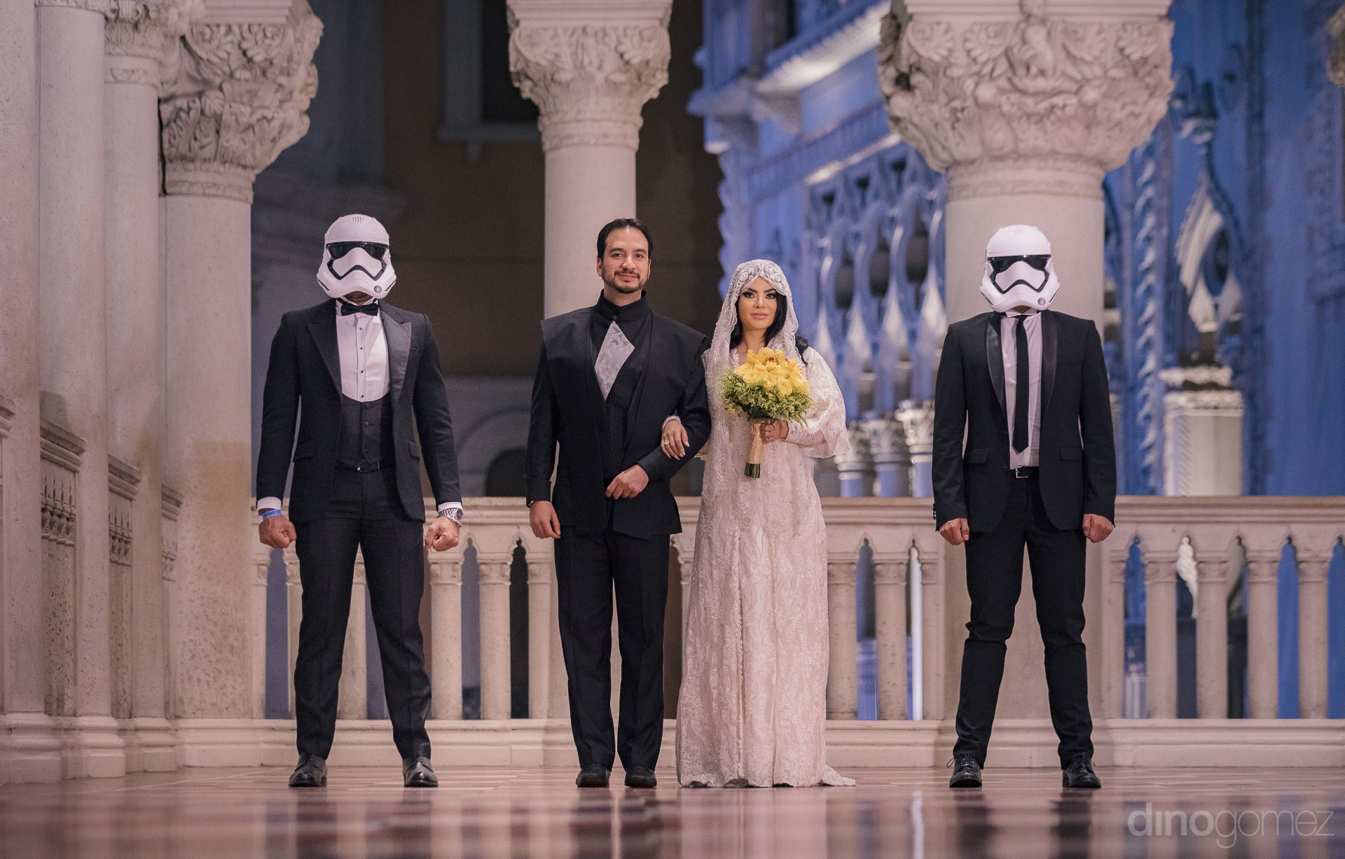 newlyweds standing arm in arm with guests wearing storm trooper