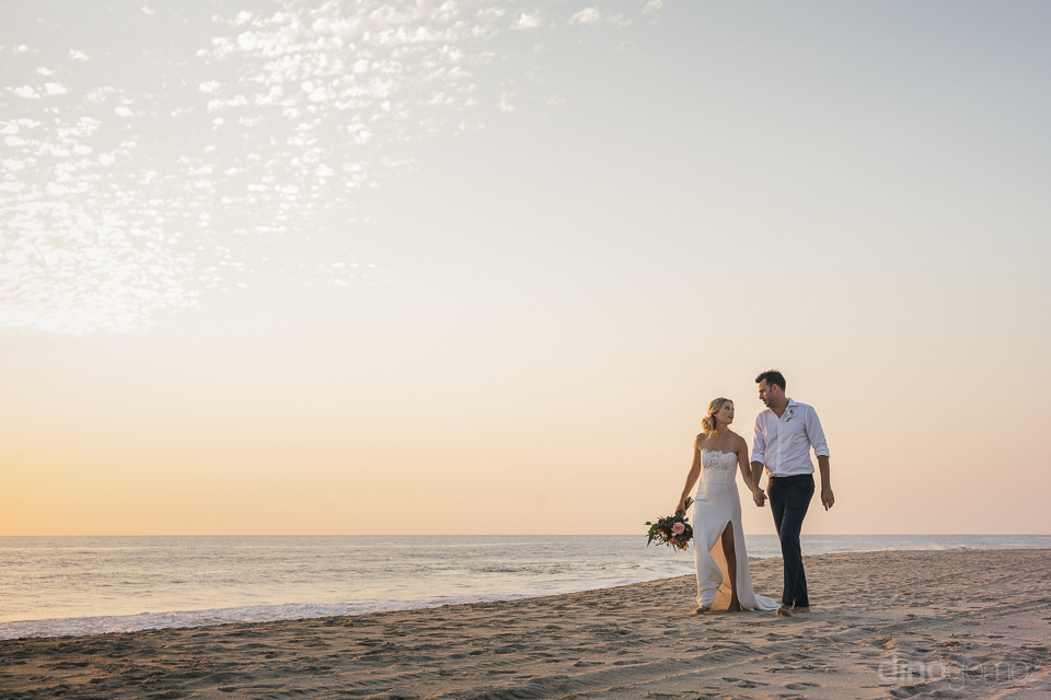 todos santos beach newlyweds walking at sunset after destination