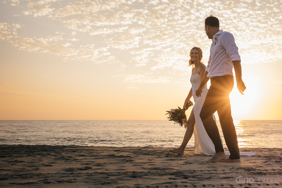 todos santos beach wedding at rancho pescadero newlyweds walking