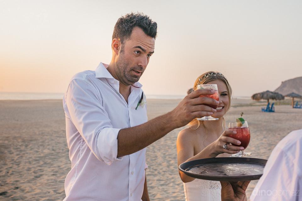 newlyweds thank waiter for bringing them some refreshing sangria