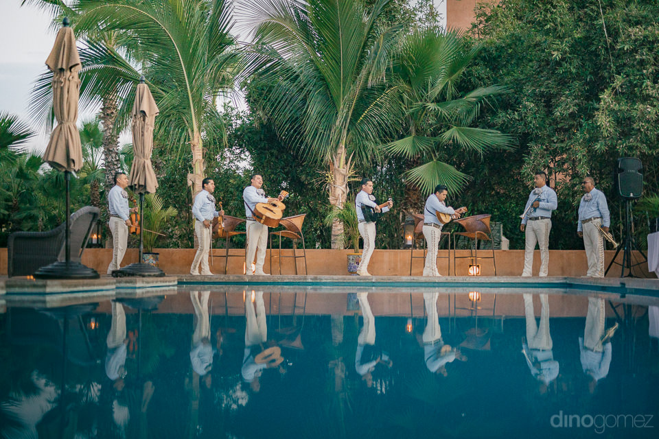 mariachi band plays by the pool at rancho pescadero resort