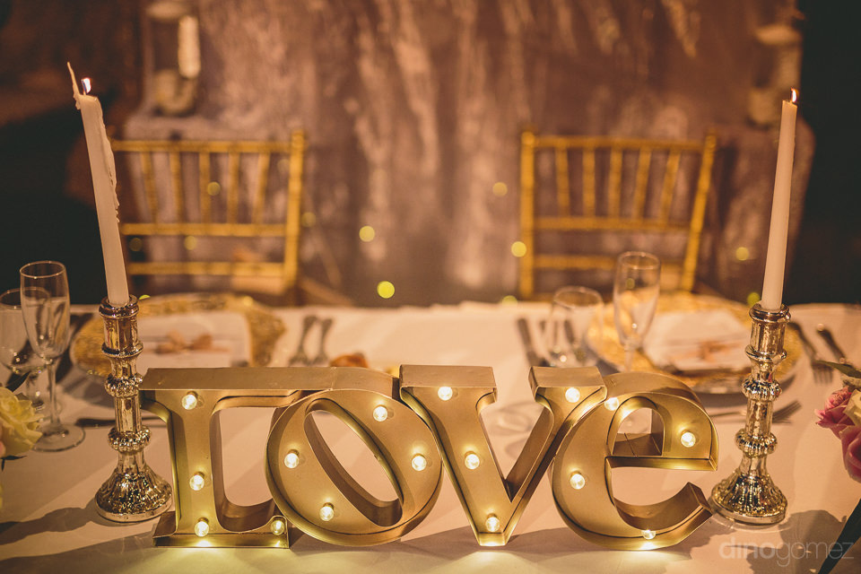 photo of the head table with illuminated love centerpiece
