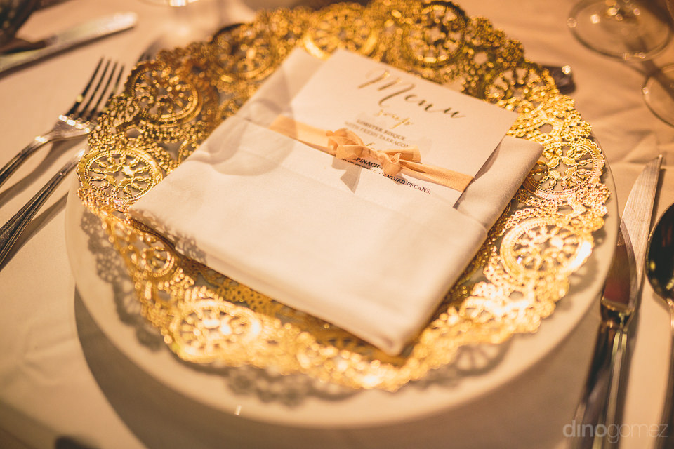 golden place setting luxury wedding in los cabos photographed by