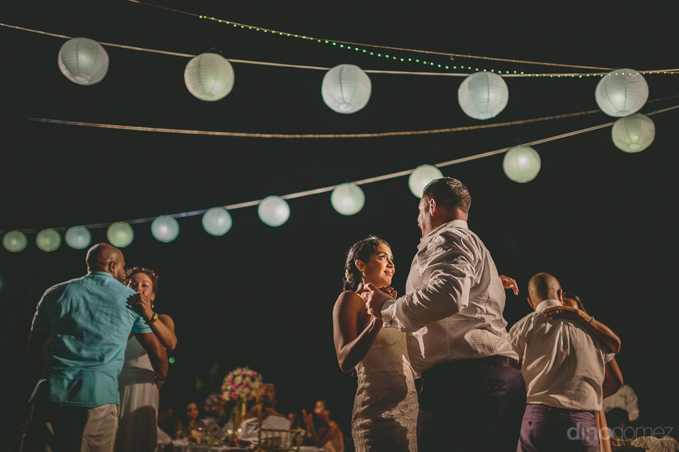 wedding guests dance close to slow song by cabos best wedding dj