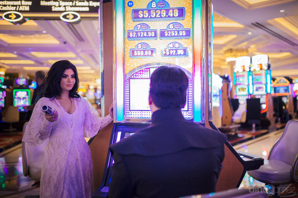 groom dressed as jedi plays slot machine while princess bride wa