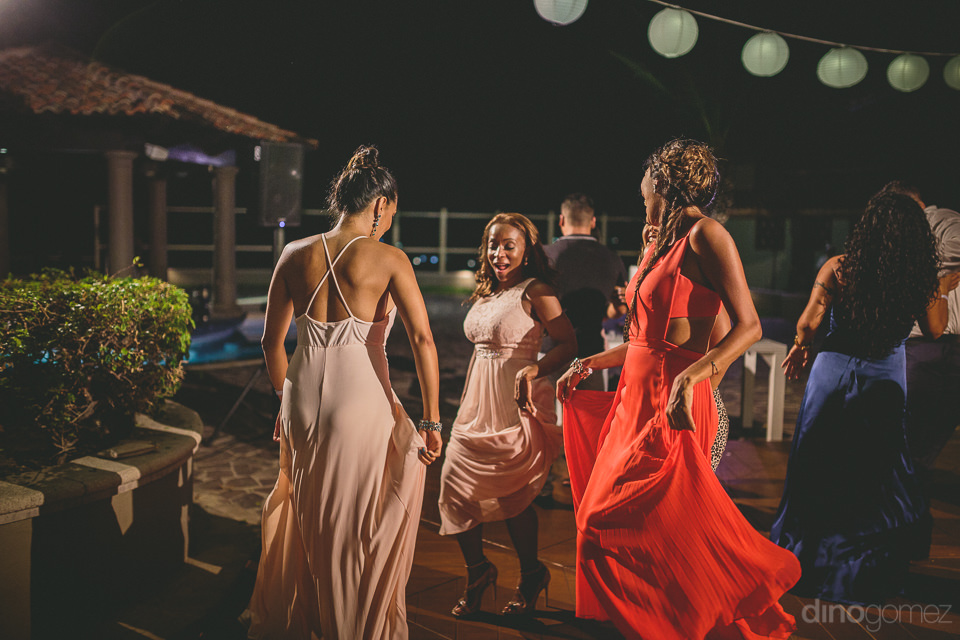 bridesmaids dance together at pueblo bonito wedding in los cabos