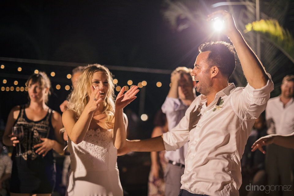 newlyweds entertain their wedding guests during the reception in