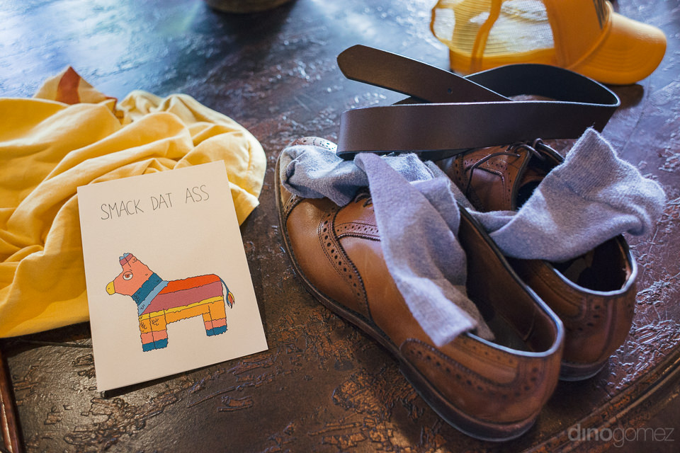 grooms shoes socks belt yellow hat before destination wedding