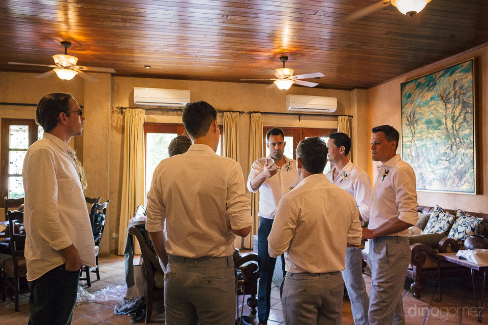 groom meets with groomsmen on the morning of the wedding