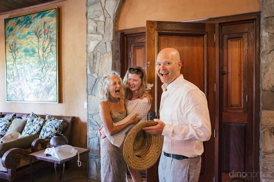 wedding guests are excited and laugh together before the wedding