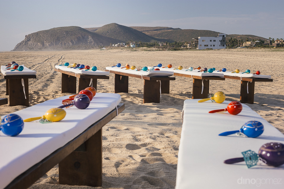 colorful personalized mexican maracas lie on top of the guests w