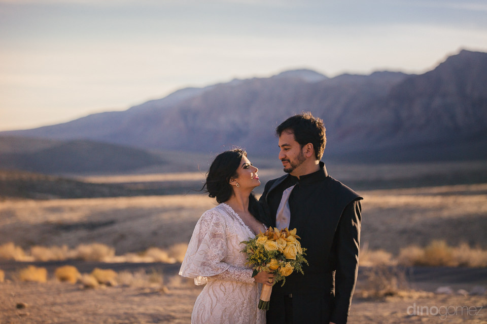 young loving newlyweds in expansive desert mountain range