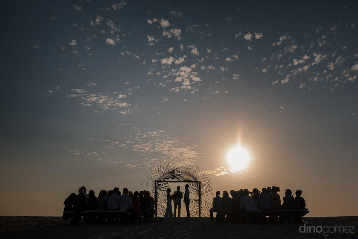 Silhouette Wedding Ceremony Photo On The Beach In Mexico Artisti