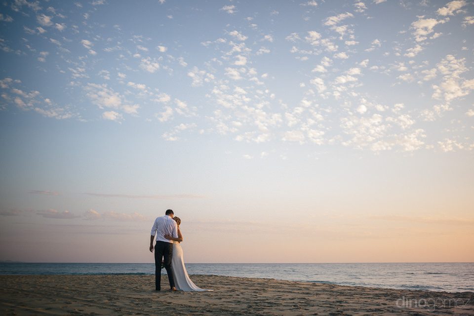 newlyweds alone on the beach in baja california sur in wedding p