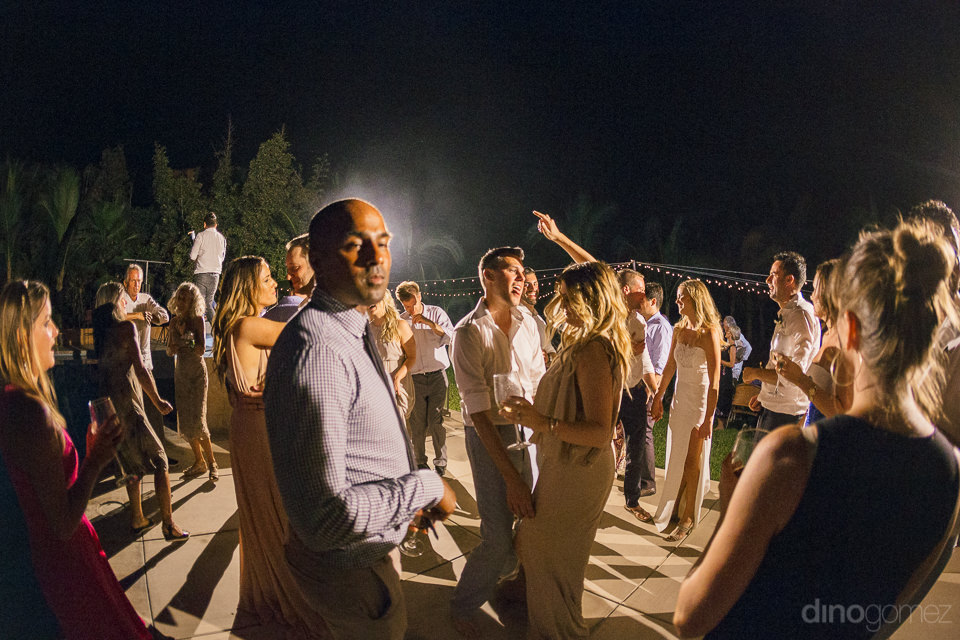lively wedding reception guests dancing at rancho pescadero hote