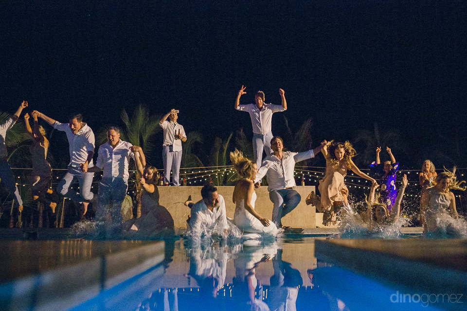 newlyweds and their guests land in pool after jumping in