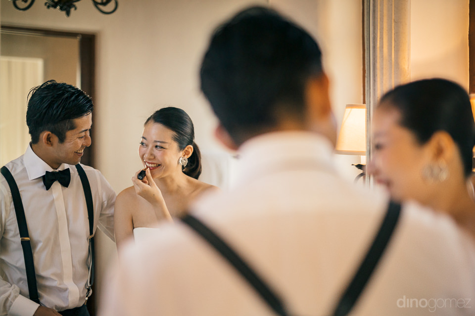 japanese bride and groom get ready for wedding together before c