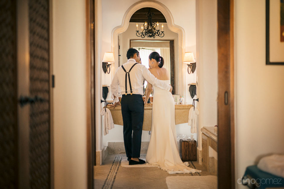 bride and groom together in bathroom before destination wedding
