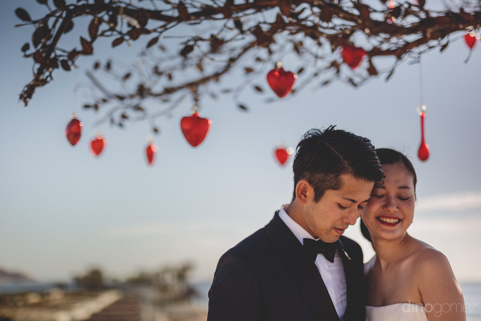 newlyweds in breathtaking wedding location los cabos luxury hote