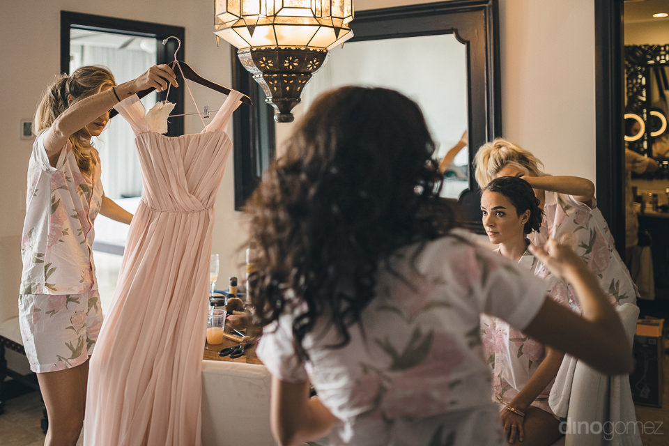 bridesmaids and bride at cabo azul hotel get ready for wedding