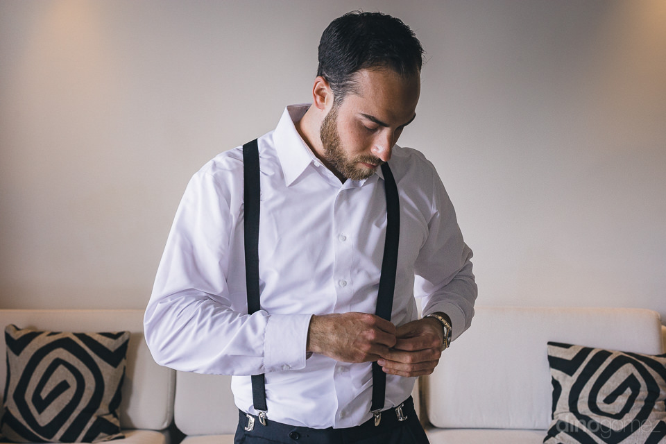 stylish groom gets dressed for cabo destination wedding