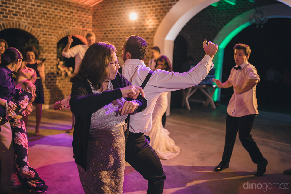 every wedding guest dances at flora farms destination wedding re