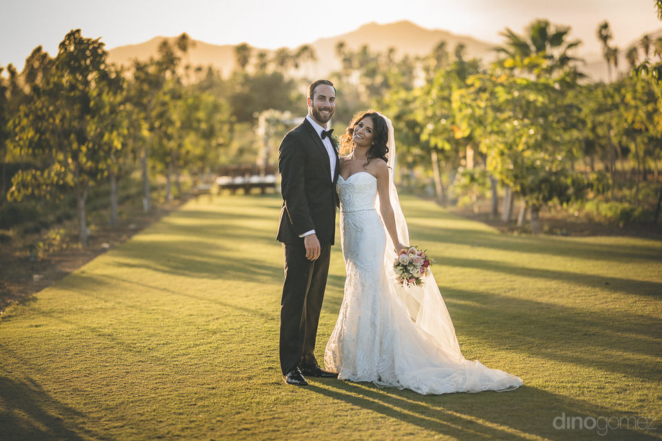 newlyweds posing for cabo wedding photographer dino gomez at bea