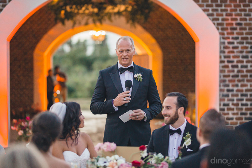 father of bride gives speech at wedding dinner organized by amy