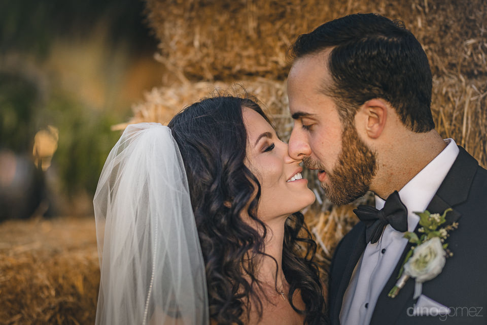 bride and groom kiss in post-wedding photo shoot by dino gomez