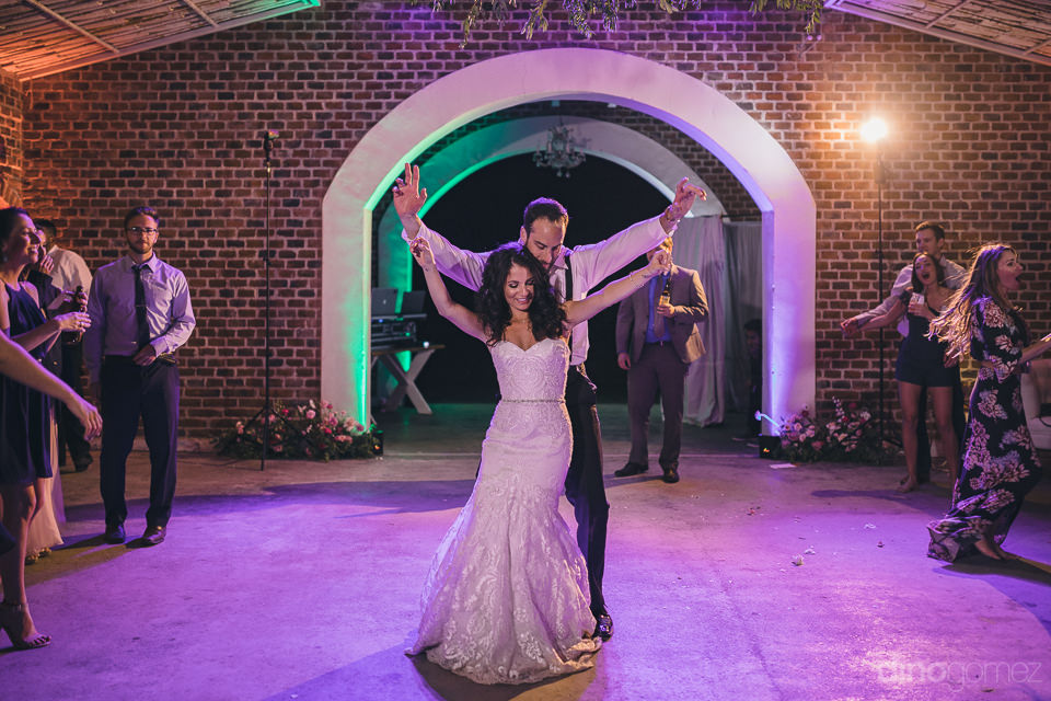 newlyweds dance together alone on the dance floor in front of ot