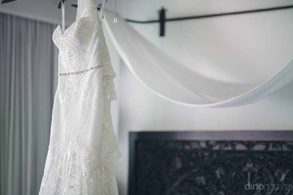 white wedding dress hanging inside cabo azul hotel resort room b