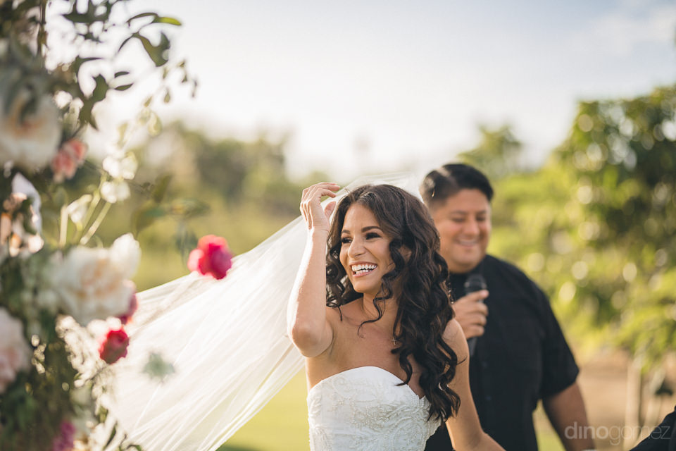 bride smiles moments after getting married at flora farms destin