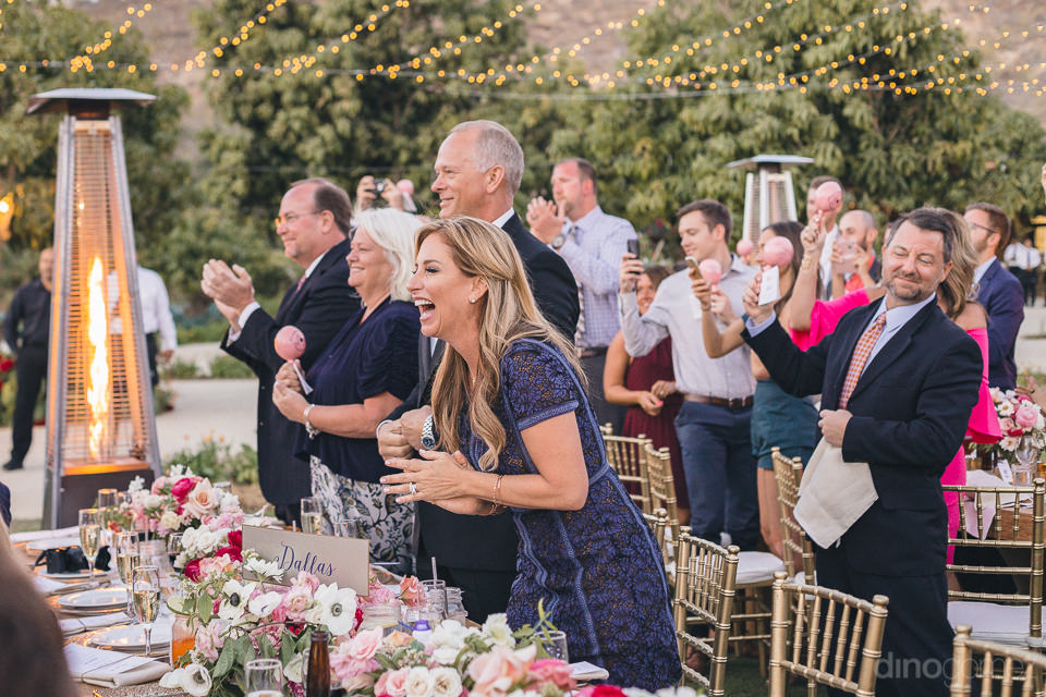 guests applaud when newlyweds tie the knot at stunning flora far