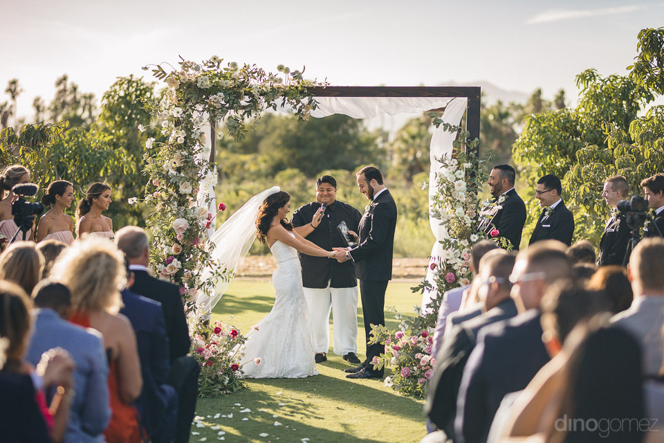flora farms outdoor wedding ceremony photo by dino gomez