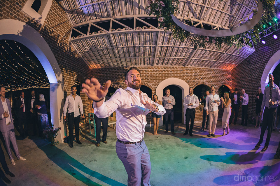 wide angle lens photo of guest dancing at luxury destination wed