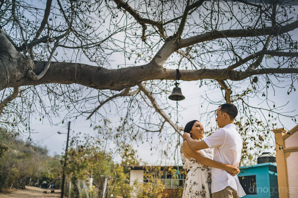 young newlyweds in village square on wedding day photographer by